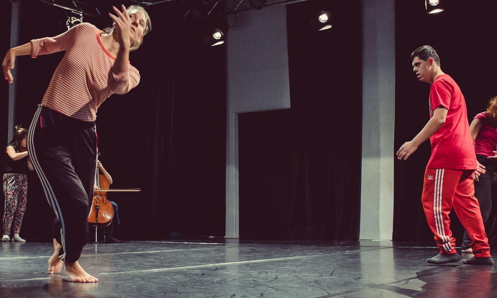 Dancer Anna Kempin and Amith Wijesinghe dancing in dynamic walking patterns to live violin and cello music.