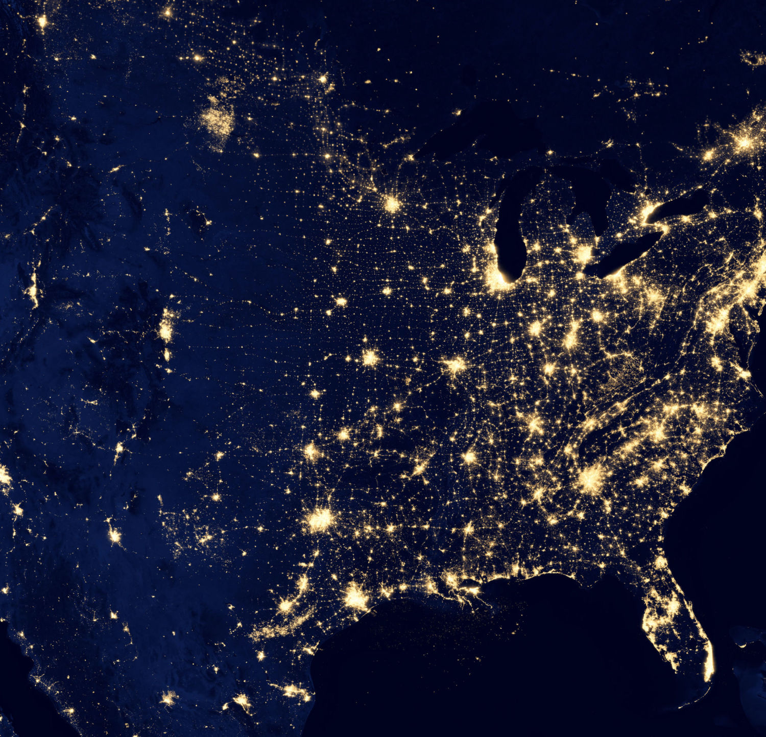 An image taken from Space of America with bright lights against a dark outline of the country to show the use of power and connectivity