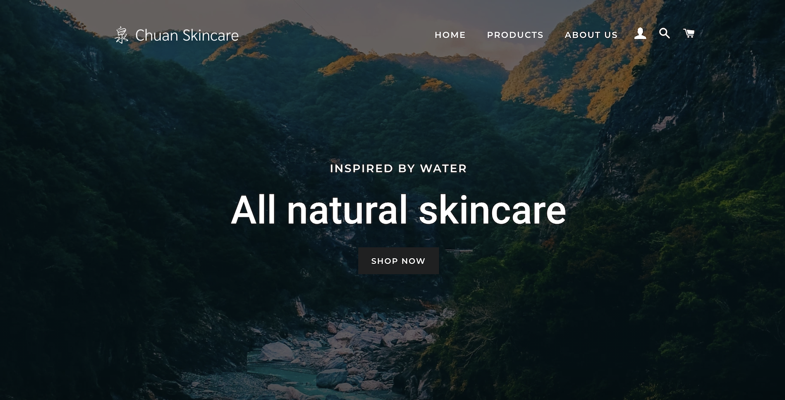 Screenshot of chuanskincare.com homepage with mountains in the background and the tagline: Inspired by water, all natural skincare