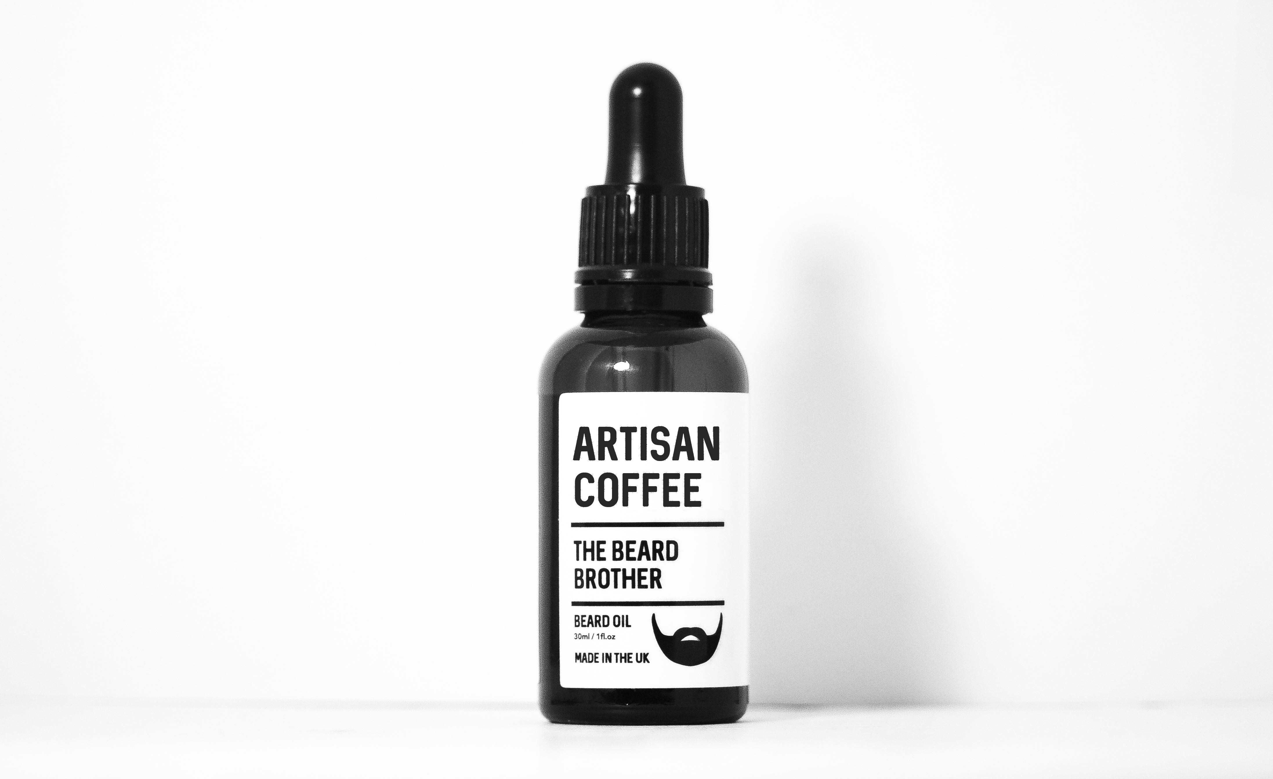 A beard oil product design and branding design pictured on a white background