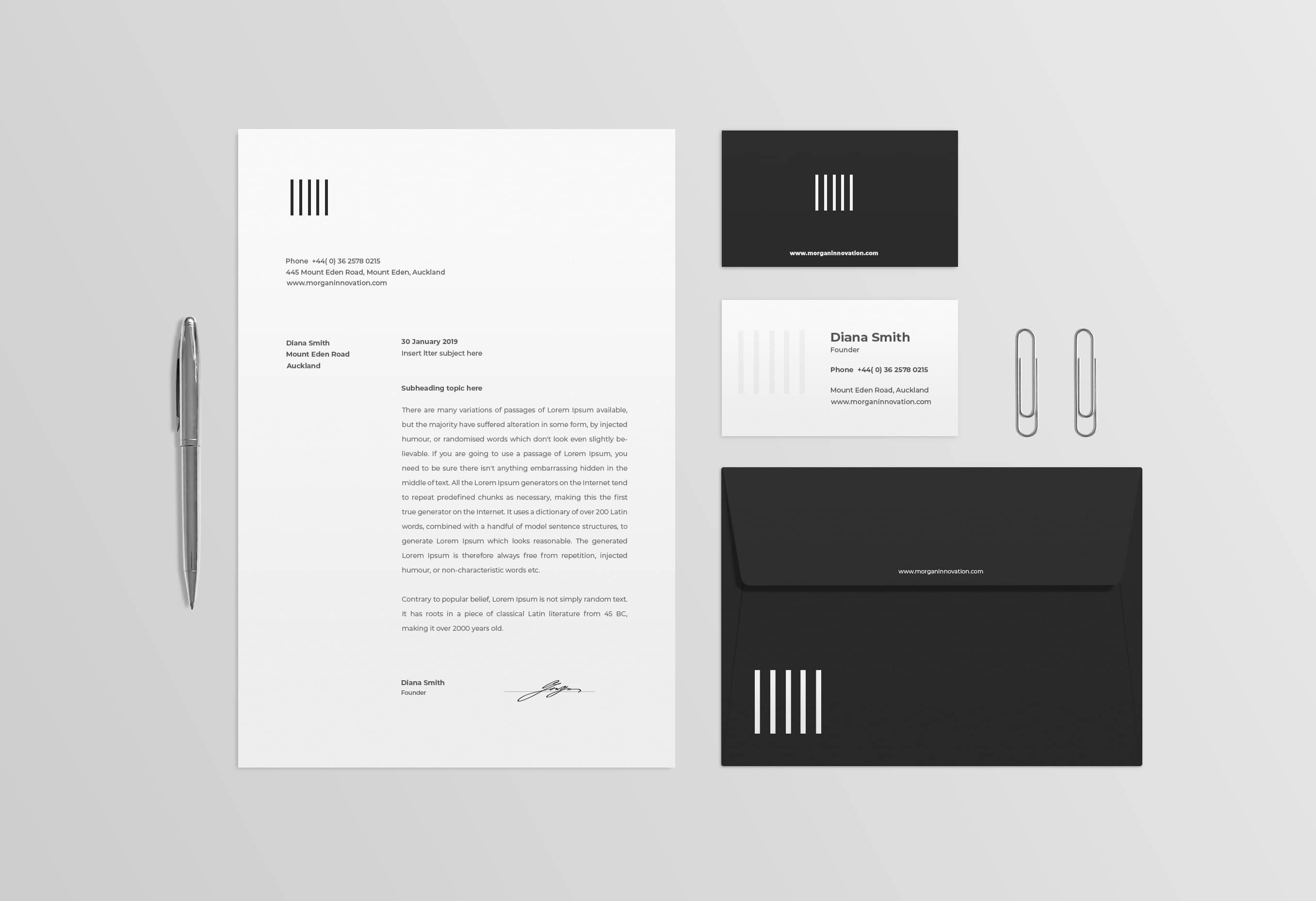 A logo design printed on a business card design for a food company with crossed knives and forks icon and called Gourmet & Graze