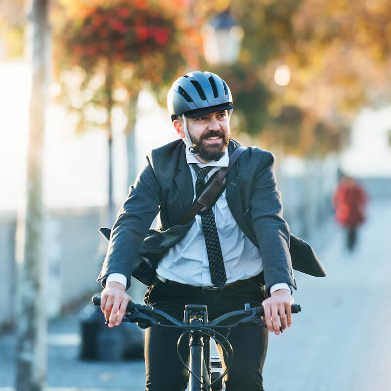 Man in suit riding a bicycle