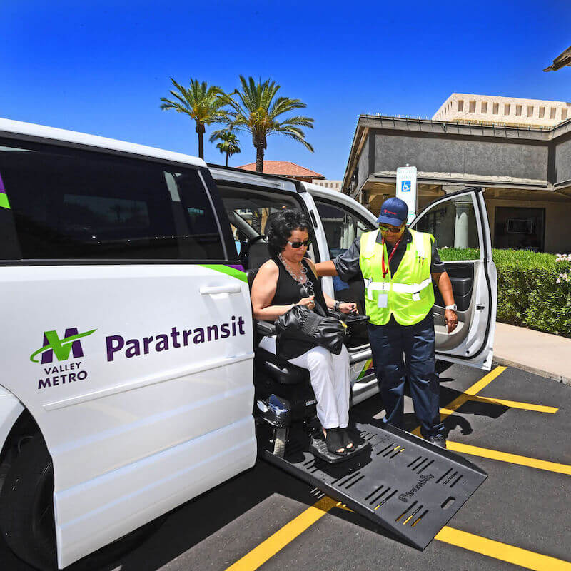 Valley Metro paratransit driver helps rider off public transit