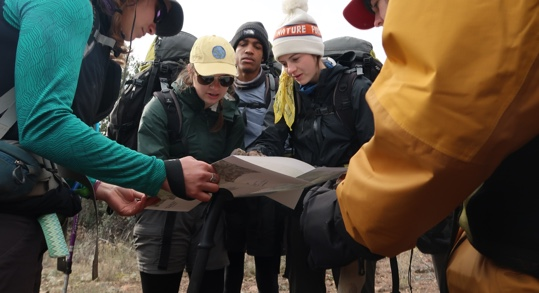 wilderness team looking at a map