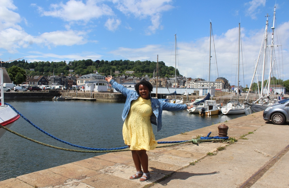 Jiana in front of a body of water in France
