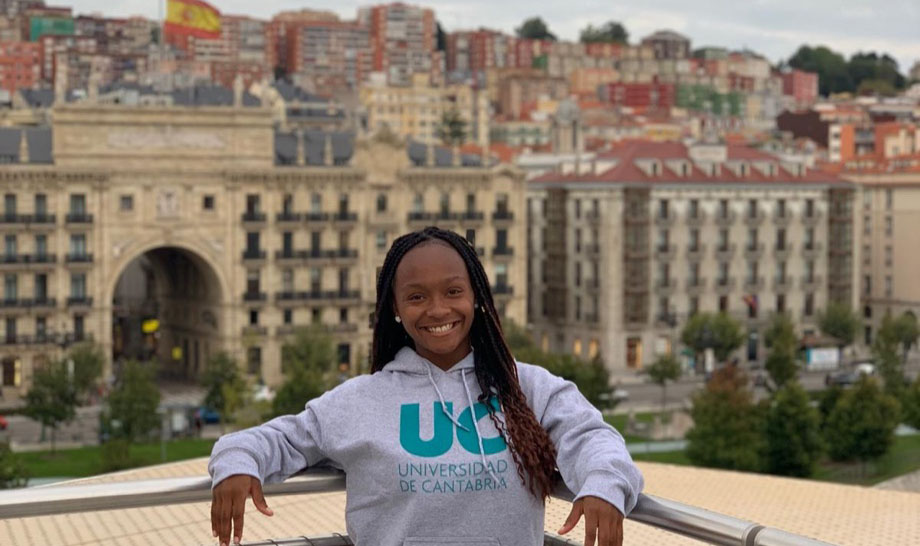 Toinette in front of a city scape in spain