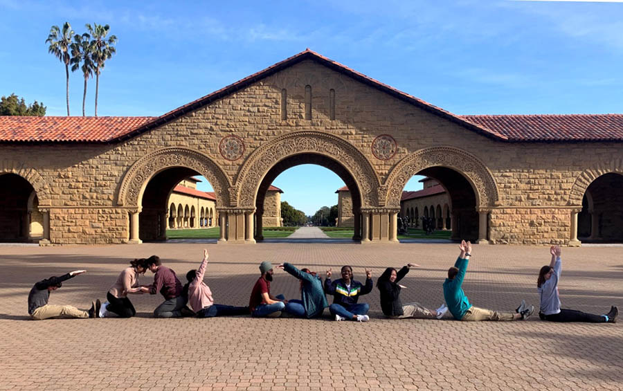 """San Fransisco team at Stanford, spelling out """"Caldwell"""" with their bodies"""