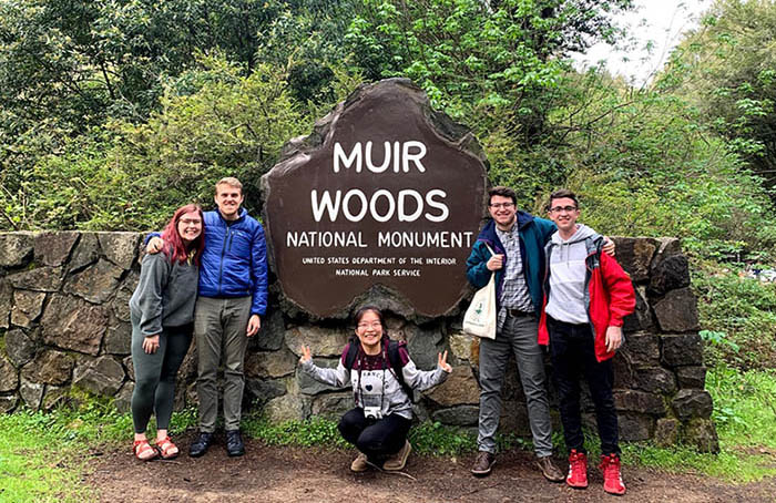 San Francisco team in front of Muir Woods sign