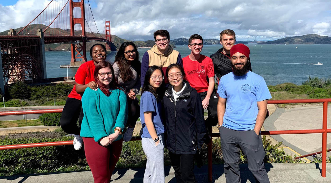 San Francisco team in front of the golden gate bridge.