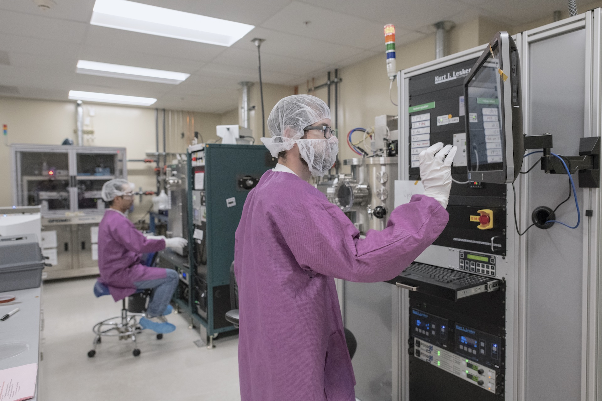 Researchers in protective gears working in a lab.