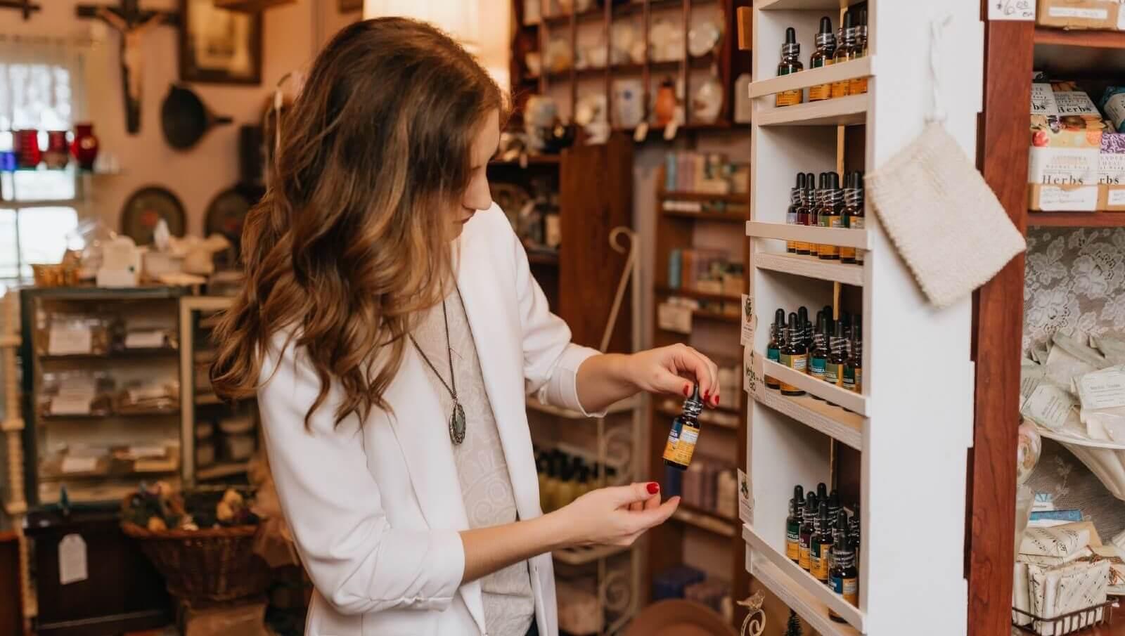 pharmacist looking at vitamins