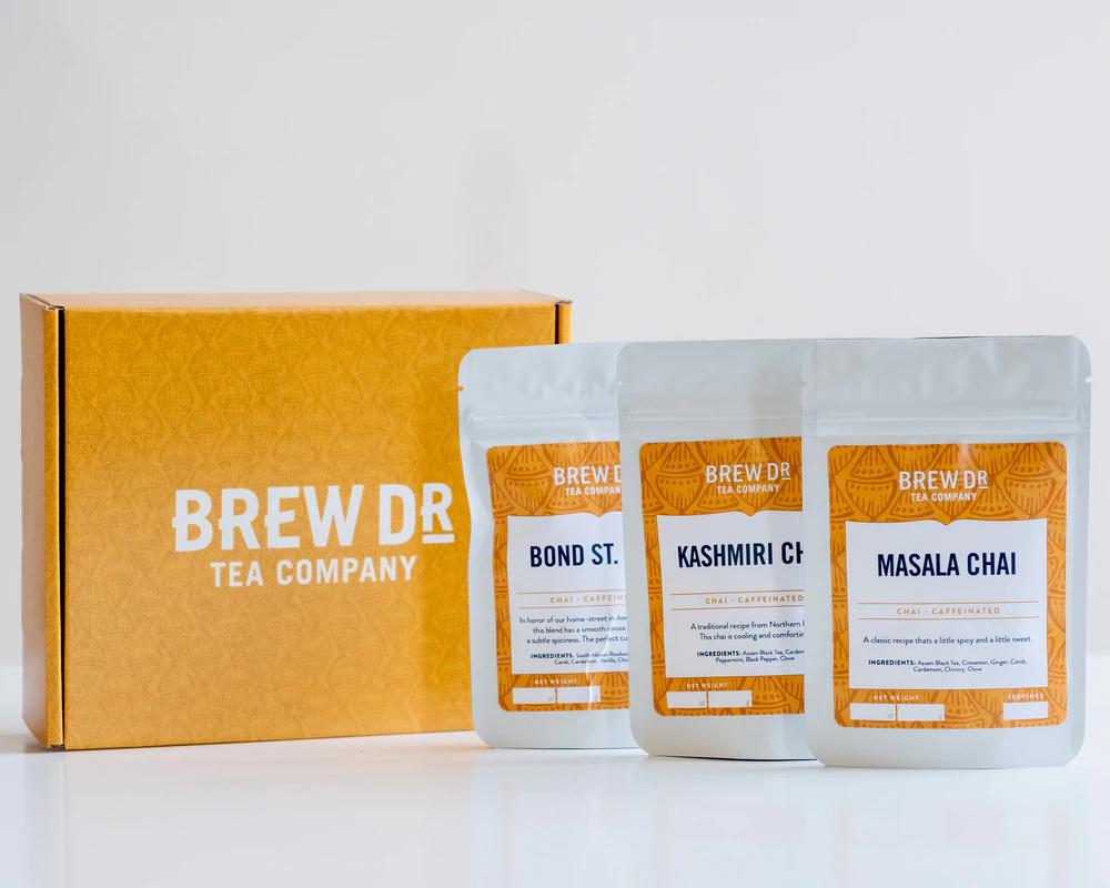 Three bags of chai tea next to a yellow box