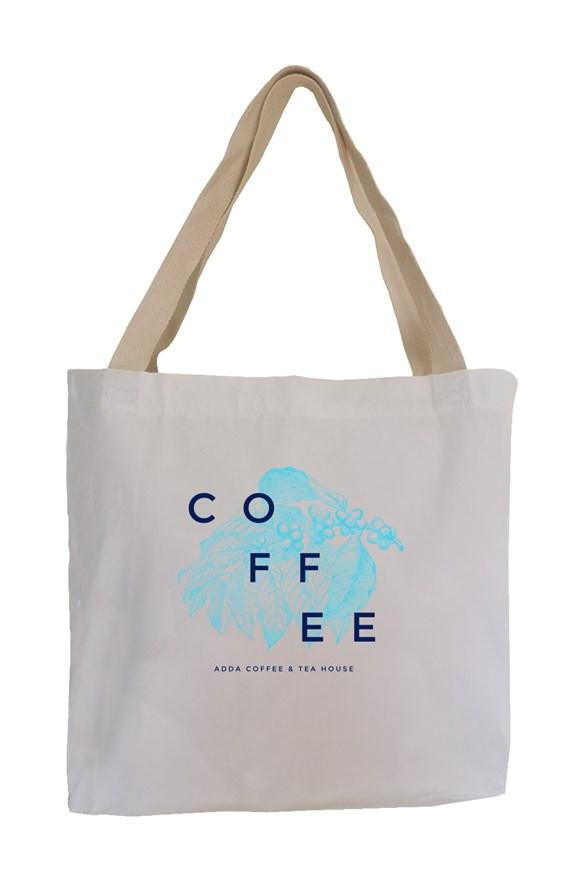 White tote bag with coffee written in blue font