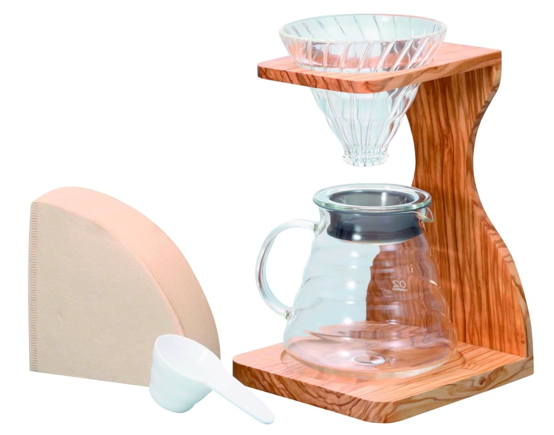 Wooden drip coffee set with glass dripper, serving carafe, measuring spoon, and paper filters