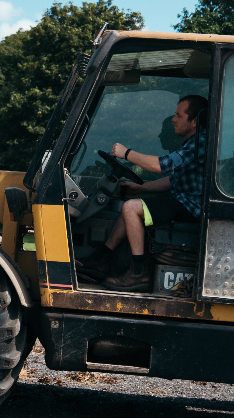 A plant driver at work wearing Tended's safety wearable