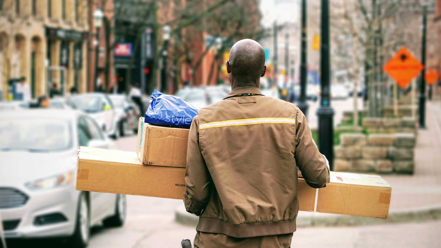 Delivery driver working alone delivering post