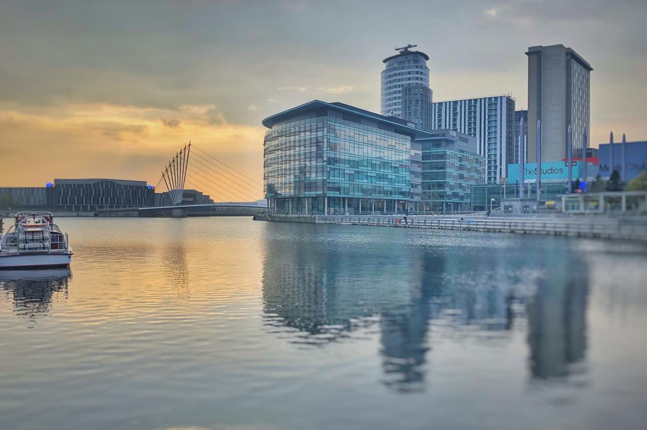 An external view of BBC studios next to a river.