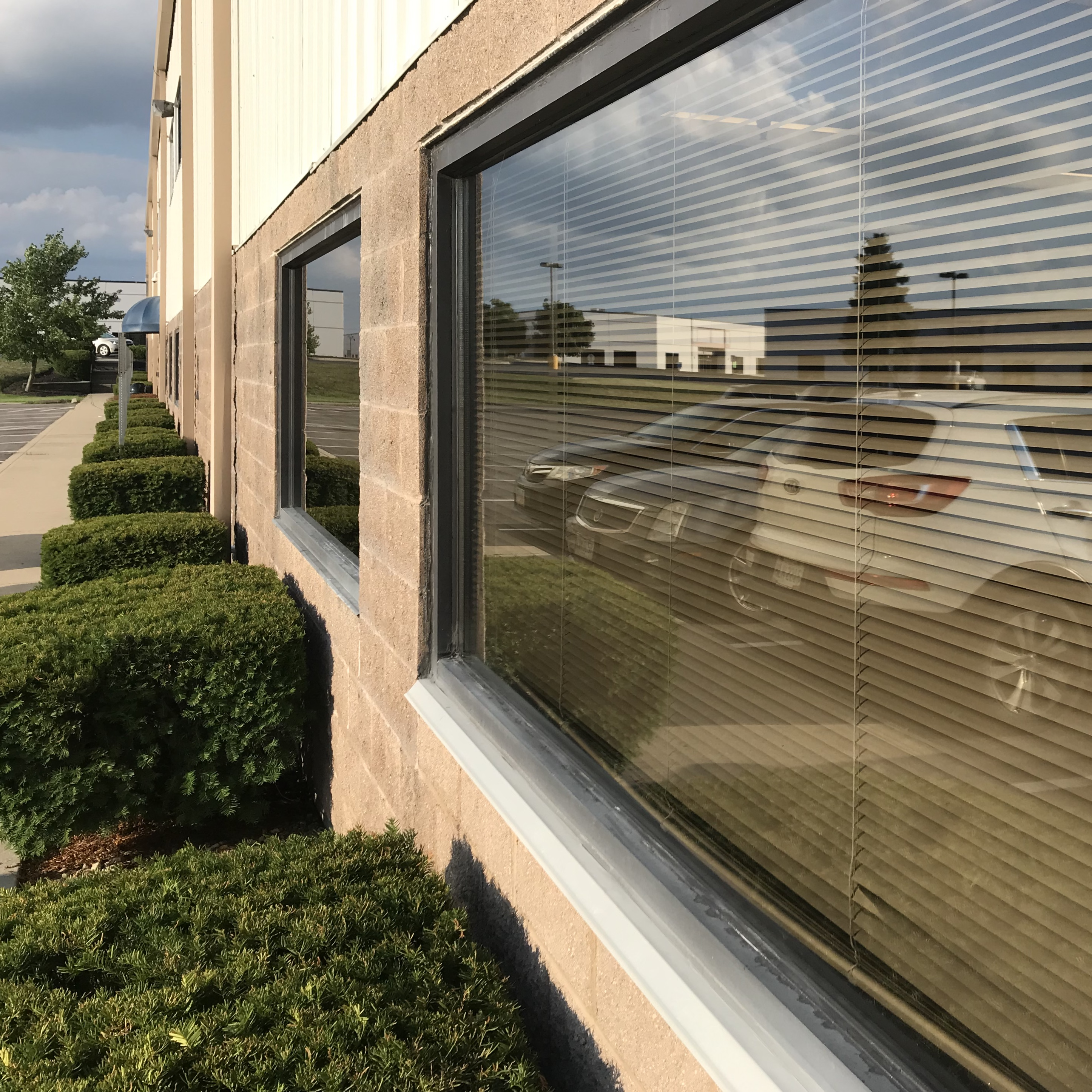 Front side of a commercial building with windows cleaned by Yellow Kord