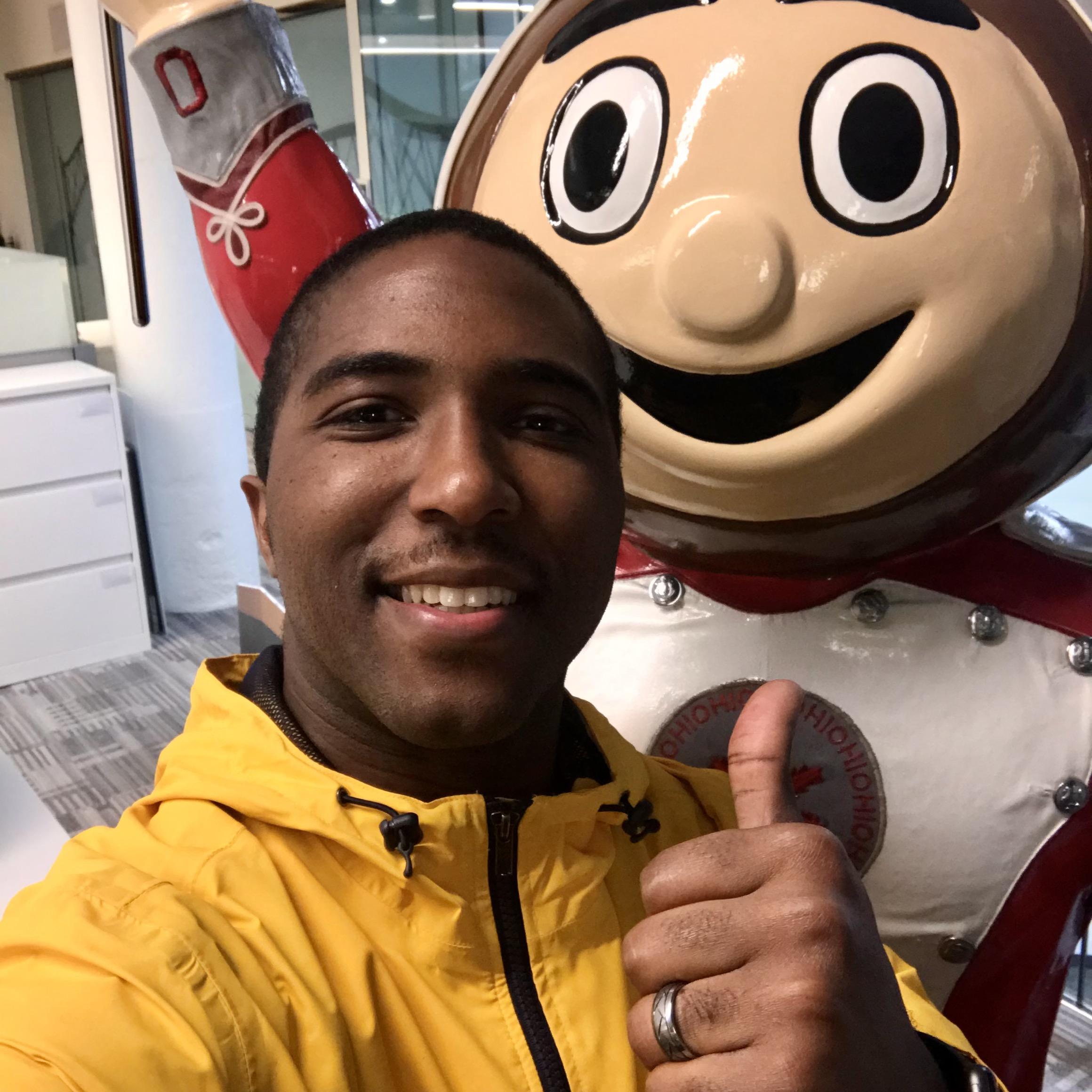 Yellow Kord employee with Brutus Buckeye mascot of Ohio State University