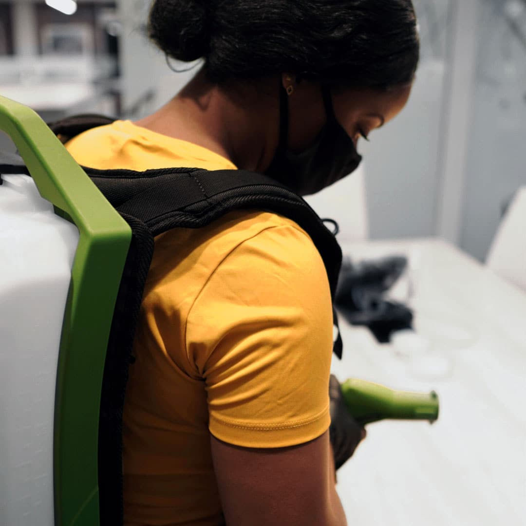A Yellow Kord employee performing disinfection cleaning services