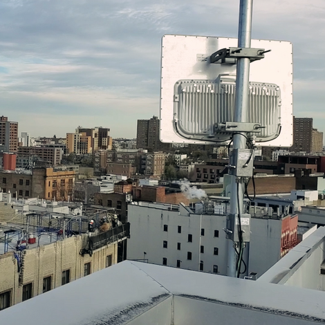rooftop photo of a NYC building with a Wi-Fi community antenna installed