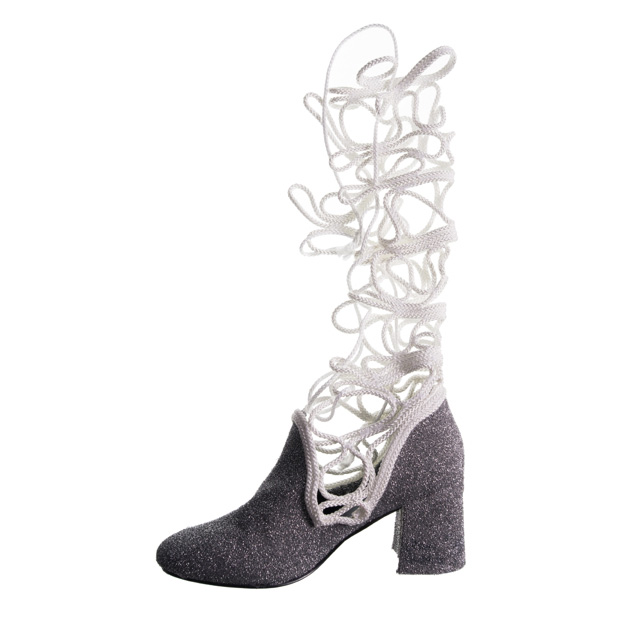 one glitter boot on a white background, the shaft of the boot consists of a thin white rope that has been folded in swirls and zig-zagged together to form a net
