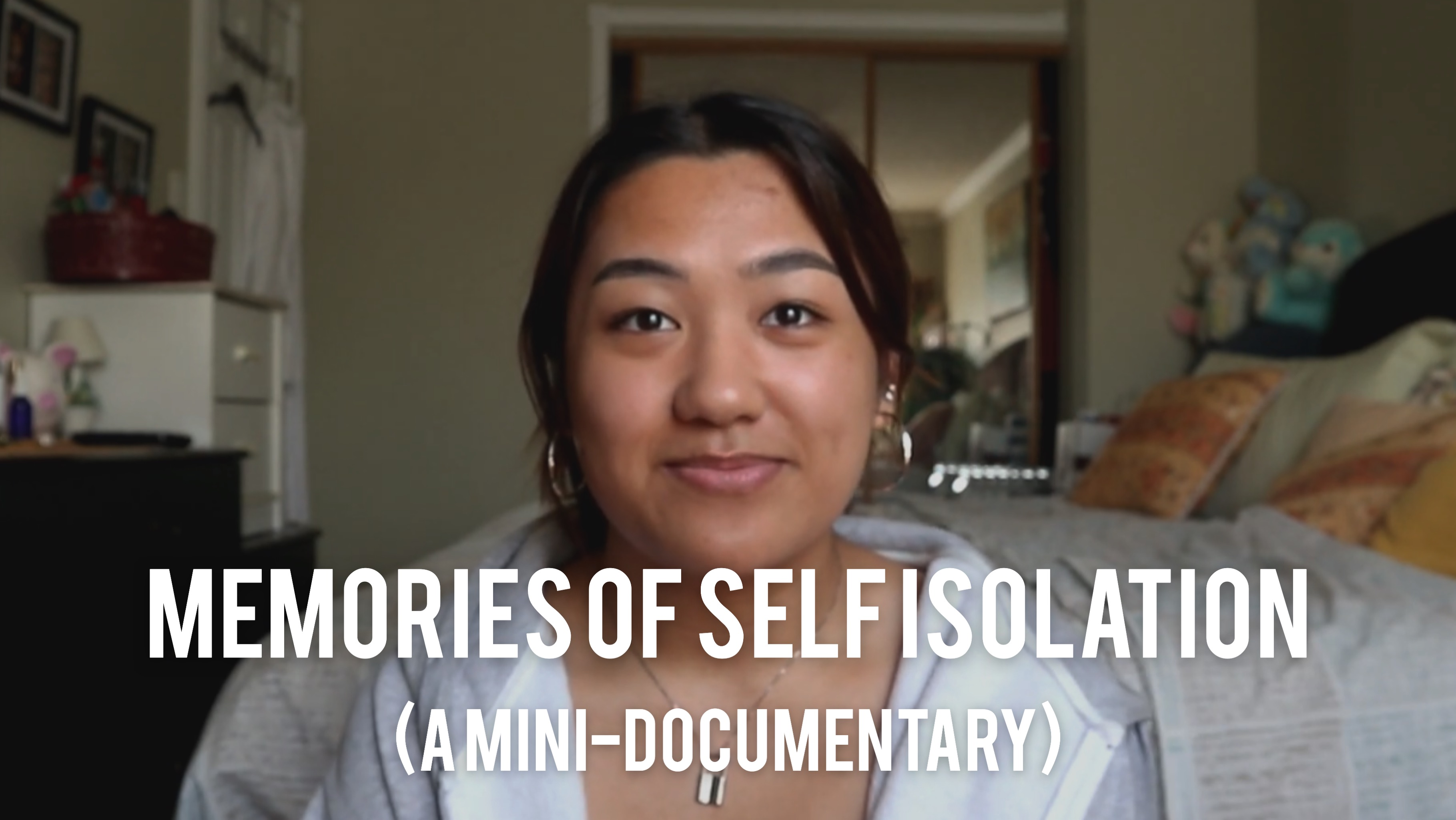 portrait of a woman facing the camera with her bedroom in the background, text reads 'Memories of Self Isolation (A mini-documentary)'