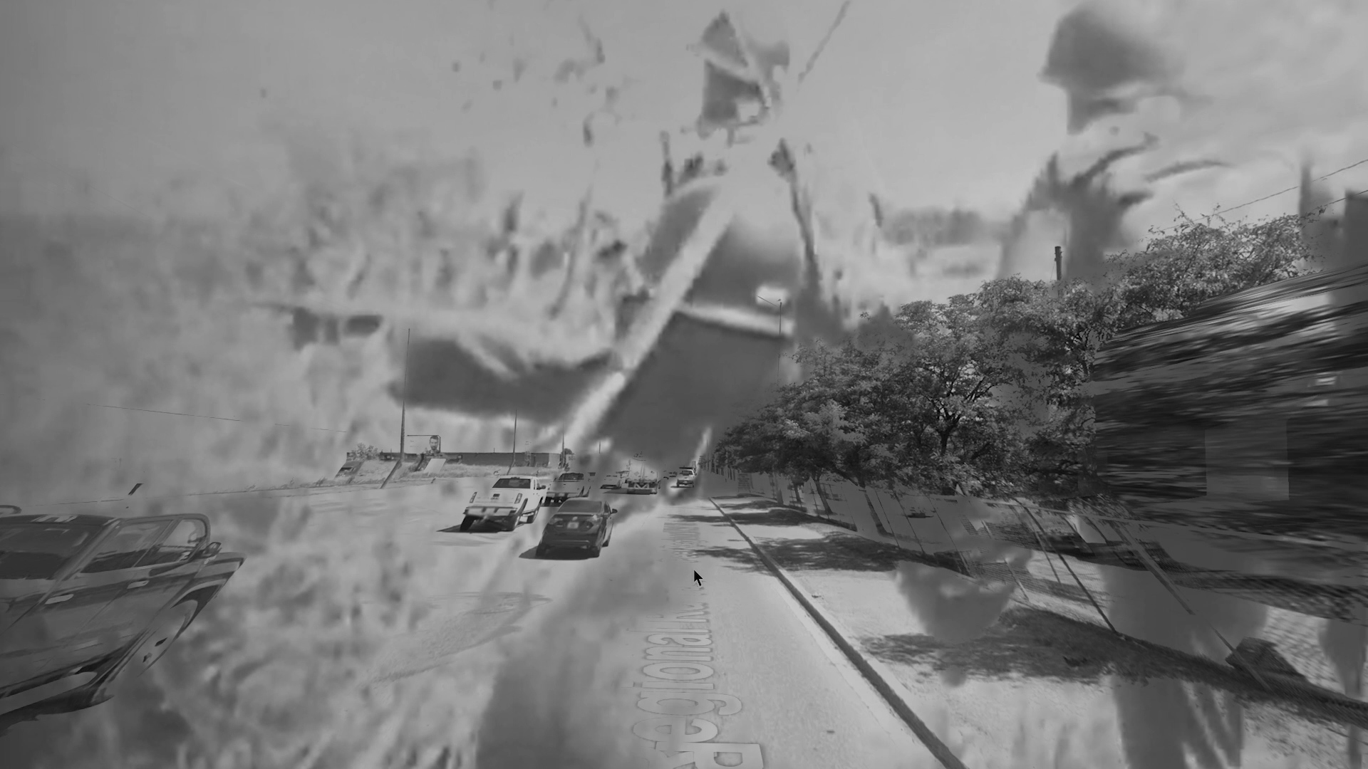 A distorted black and white image of a highway with cars; overlayed by images of men with helmets.