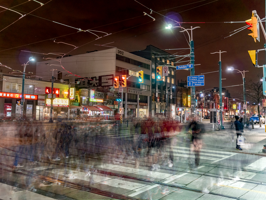 Spadina/Dundas intersection with blurred movement of pedestrians on a crosswalk