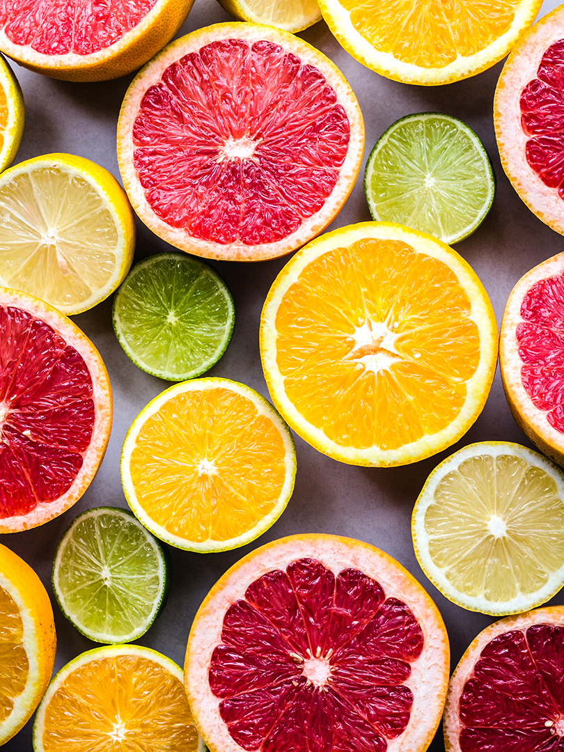 Slices of grapefruits, oranges, lemons, and limes.