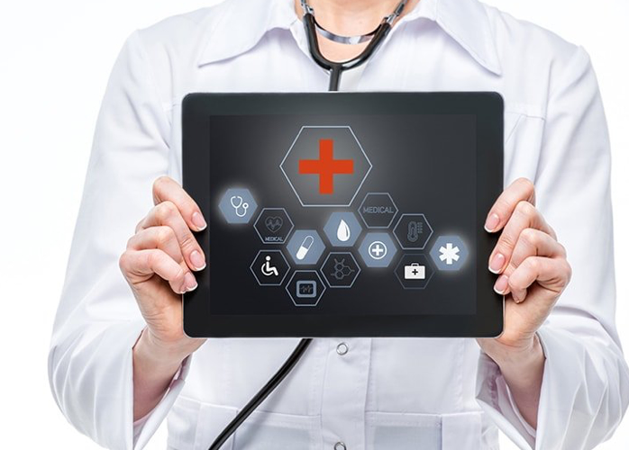 healthcare provider holding up a tablet
