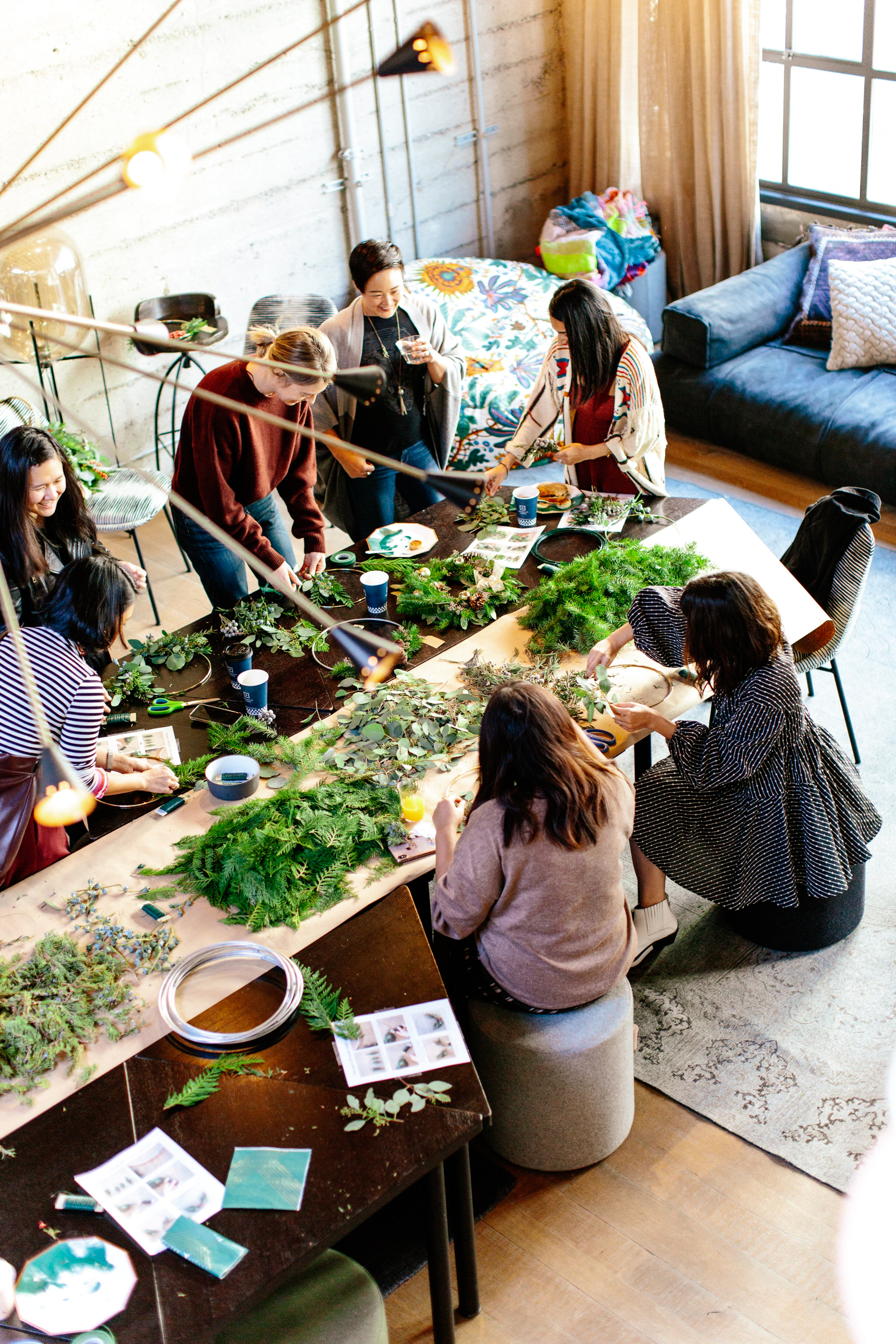 a group of women making plants in a workshop