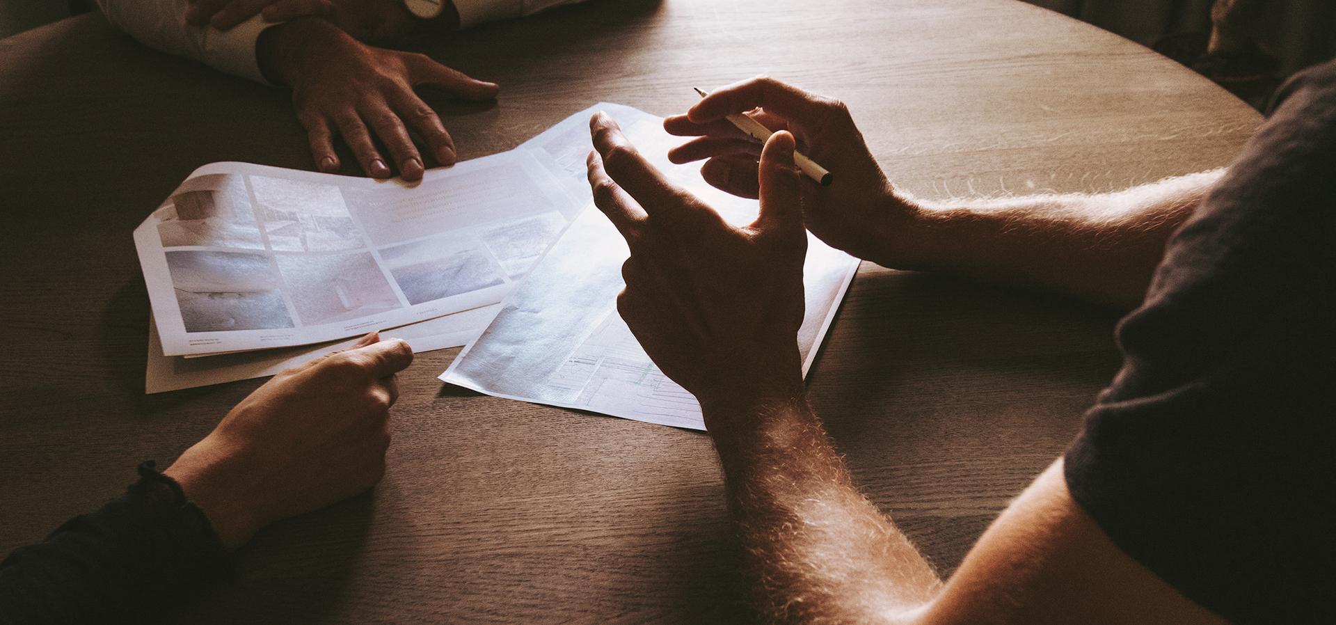 hands near a notebook working