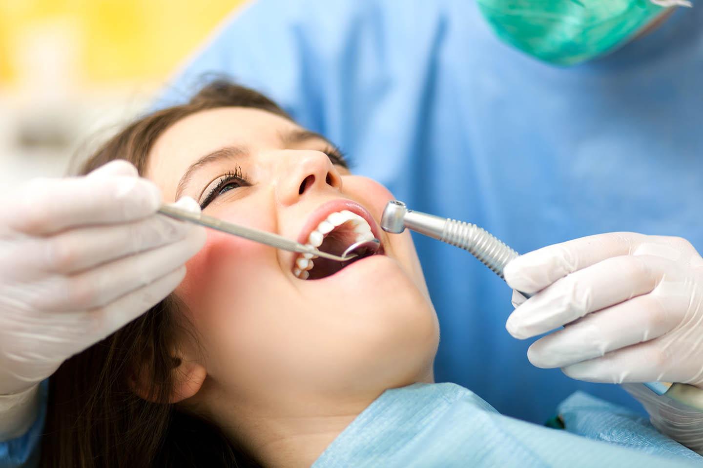 woman getting teeth cleaned