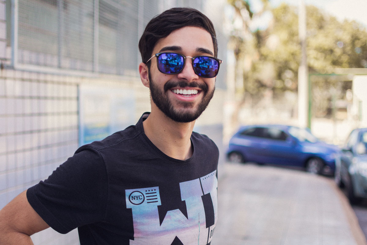 man smiling in sunglasses