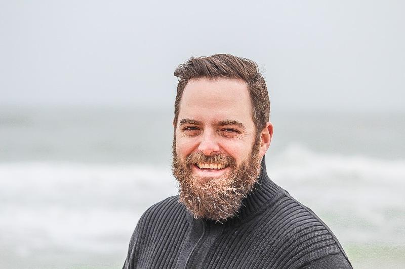 man smiling at beach