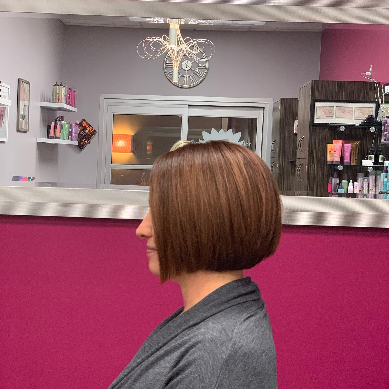 a woman getting her hair cut at studio tru hair salon