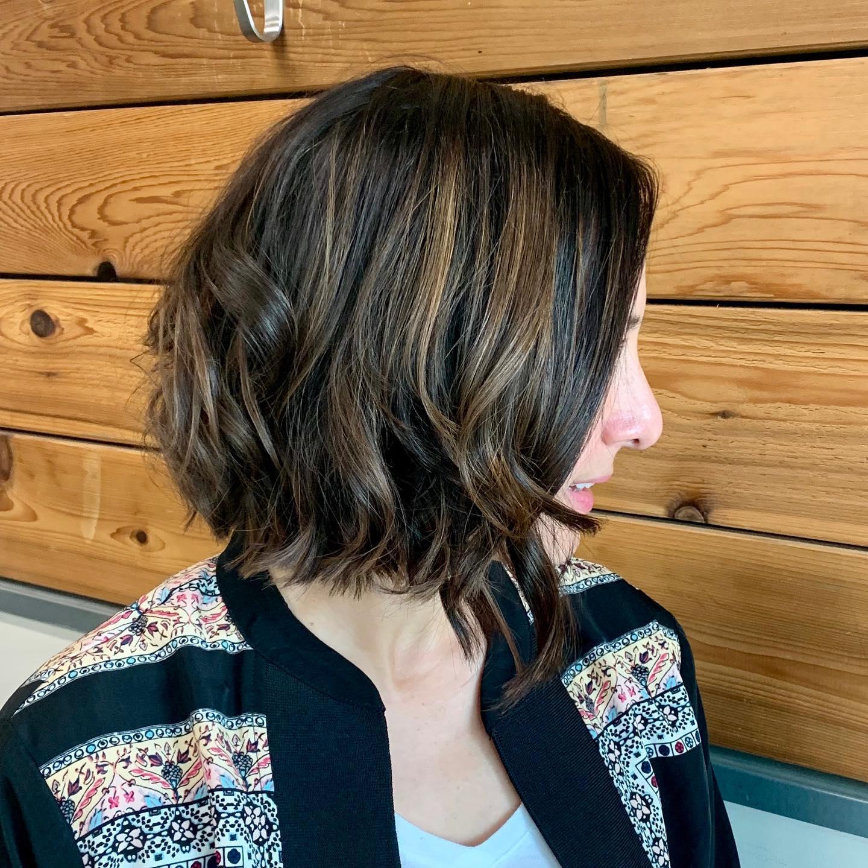 woman's haircut at hair salon