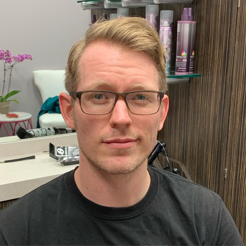 man with haircut at studio tru hair salon