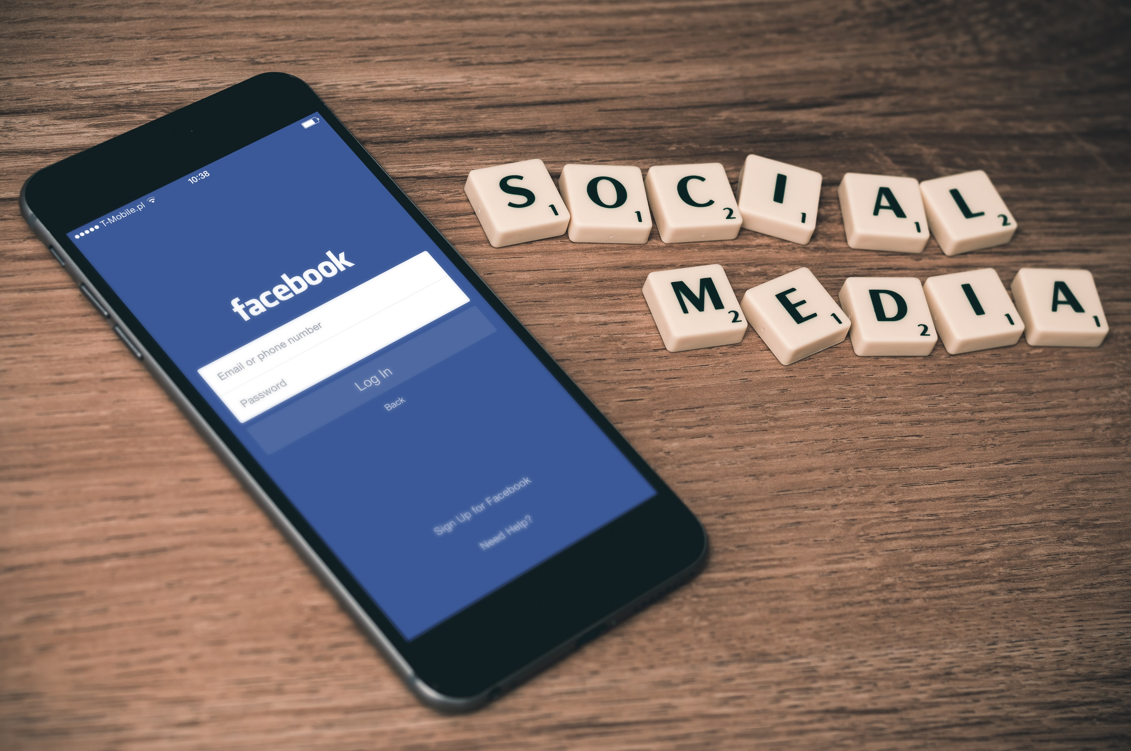 Facebook app open on iPhone and scrabble Social Media spelled out