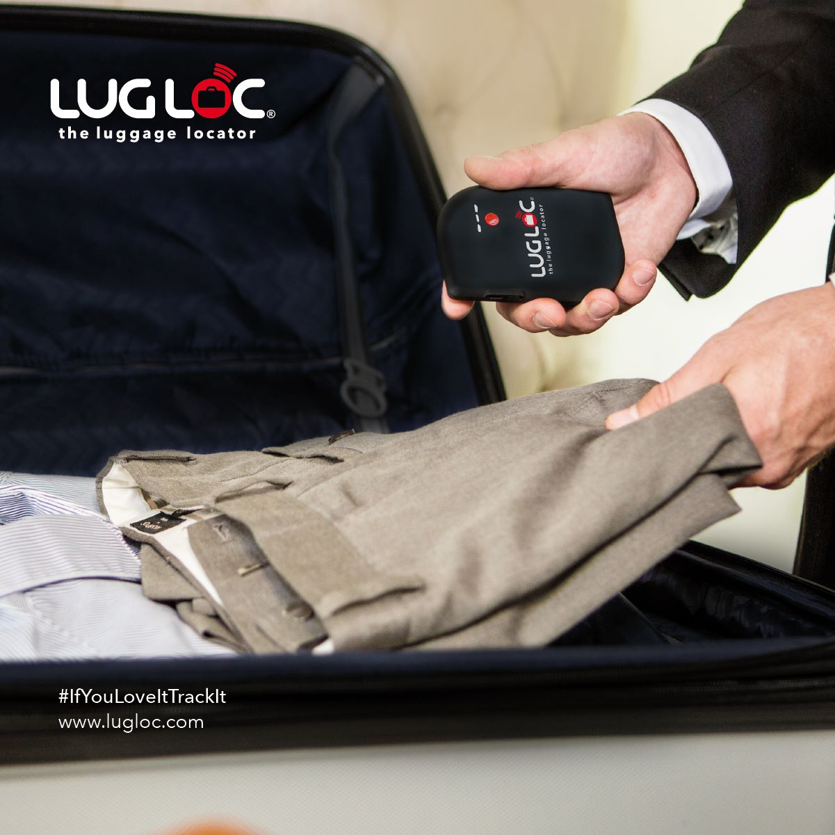 Hand holding Lugloc and putting it inside a packed luggage