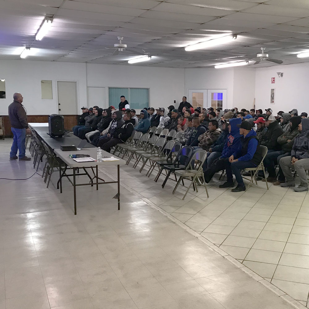 Workers seated for a recruiting program