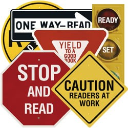 Different road signs with altered text to encourage reading. Photo courtesy of Barbershop Books.