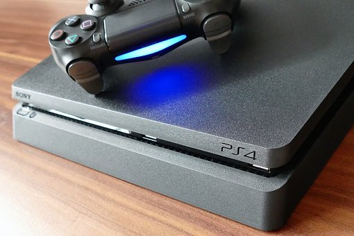 A PlayStation controller rests on a PS4. Photo courtesy of Davyahna Eldridge.