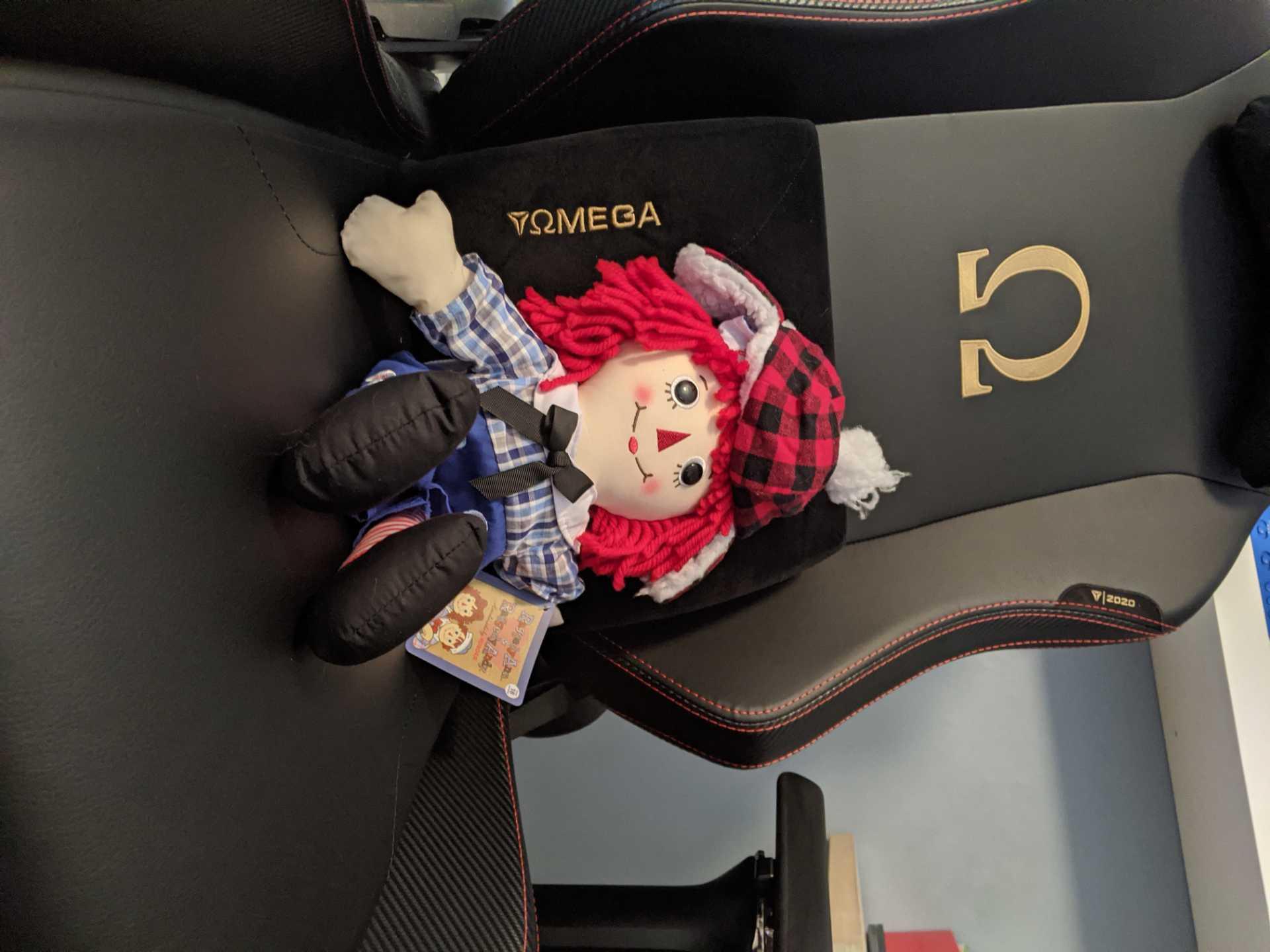 A Raggedy Ann doll in a desk chair. Photo courtesy of Maxwell Hughes.