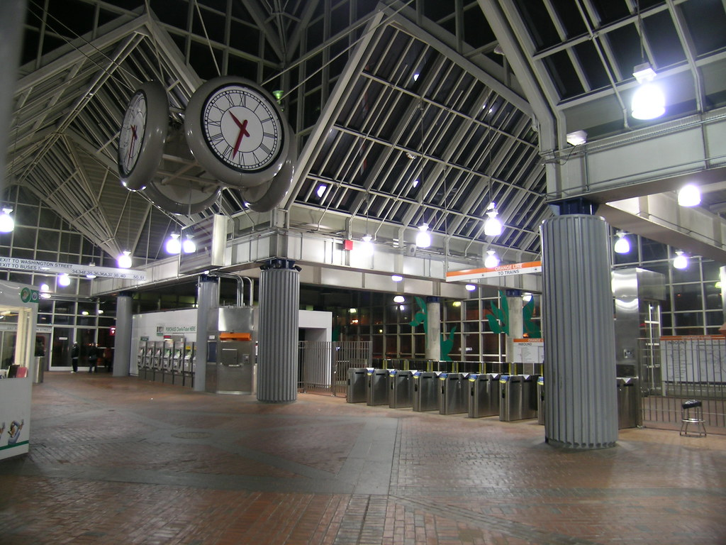 Clocks and high ceilings inside the MBTA Forest Hills Orange Line station. Photo courtesy of Maxwell Hughes.