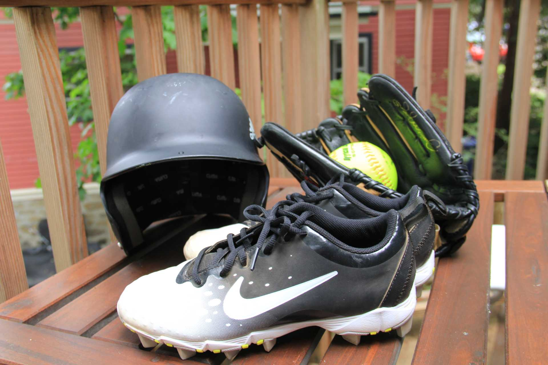 A softball helmet, glove with a softball in it, and one cleat. Photo courtesy of Lauren Johnson.