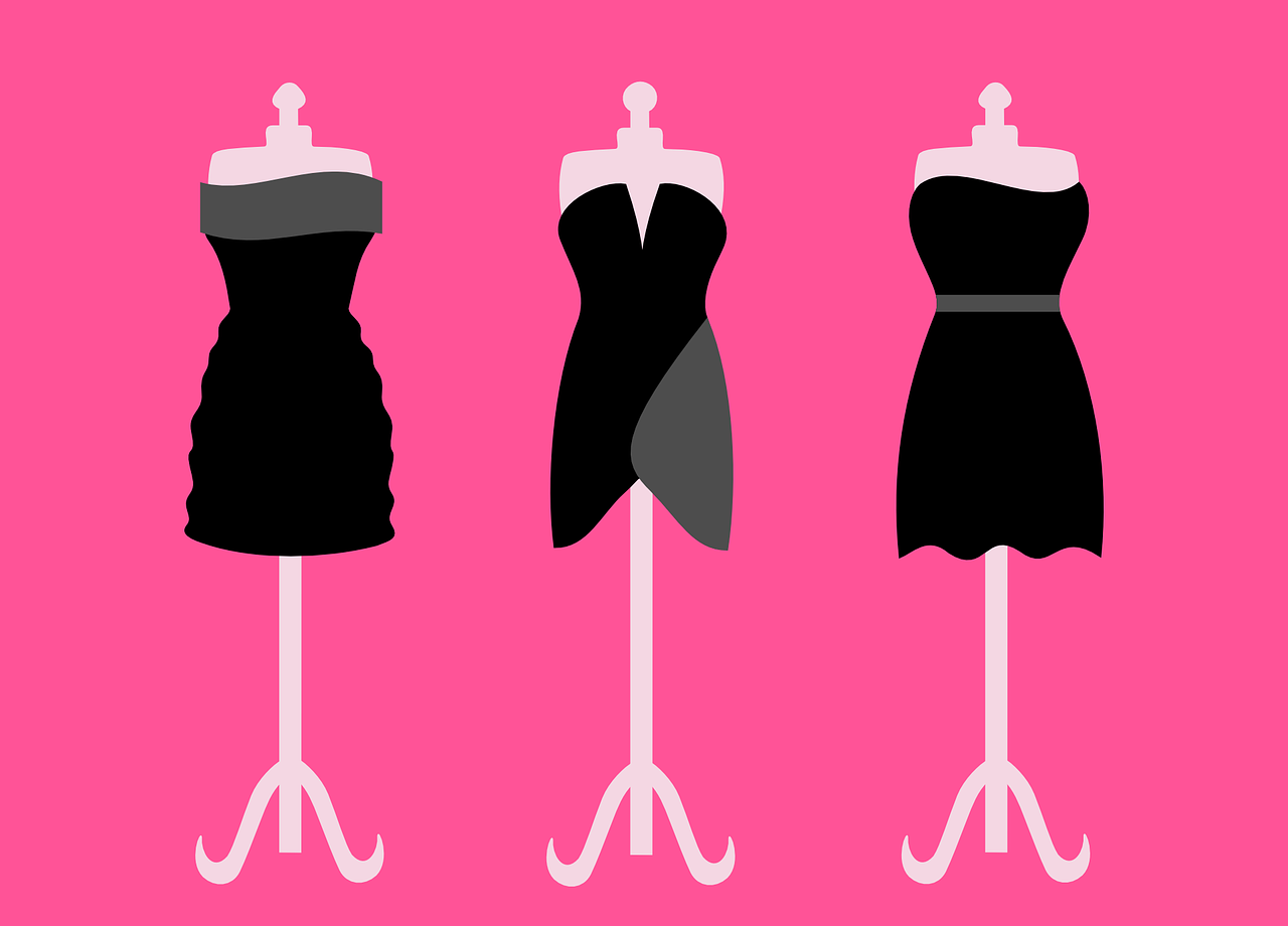 Three dresses on three mannequins.