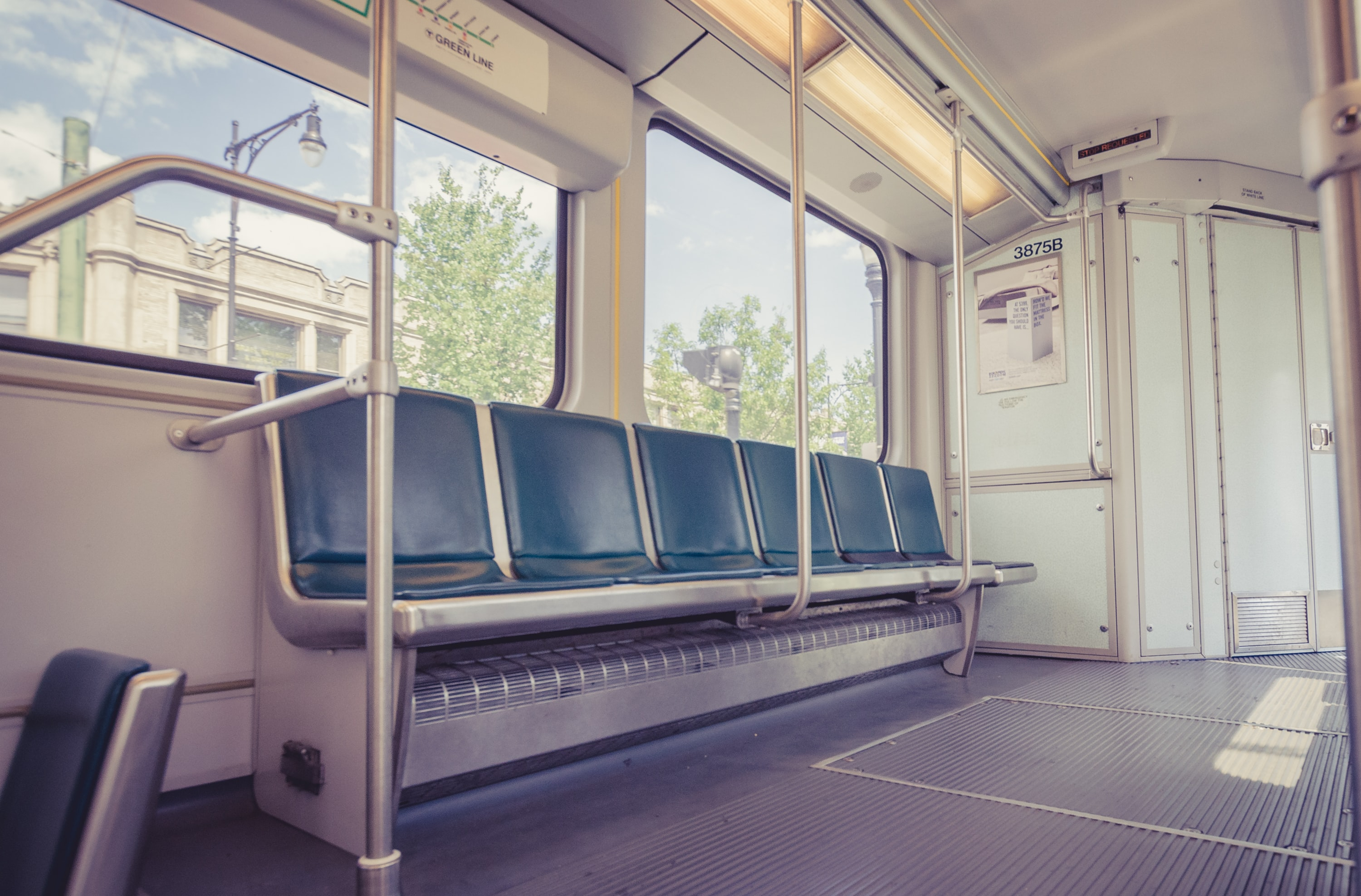 A row of seats on an MBTA green line train car. Photo courtesy of Kelly Sikkema on Unsplash.