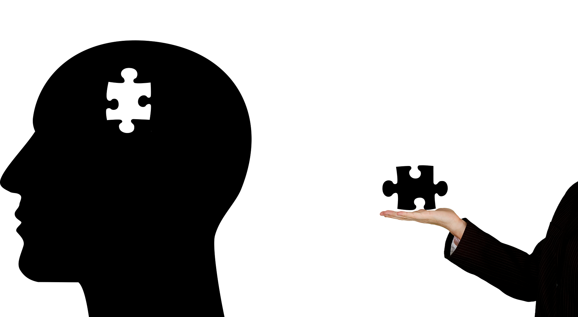 A person reaches to fit a puzzle piece in a cartoon head with a missing piece. Photo courtesy of Tumisu on Pixabay.